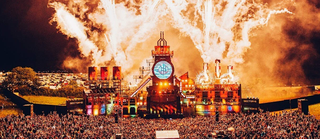boomtown festival stage with fireworks
